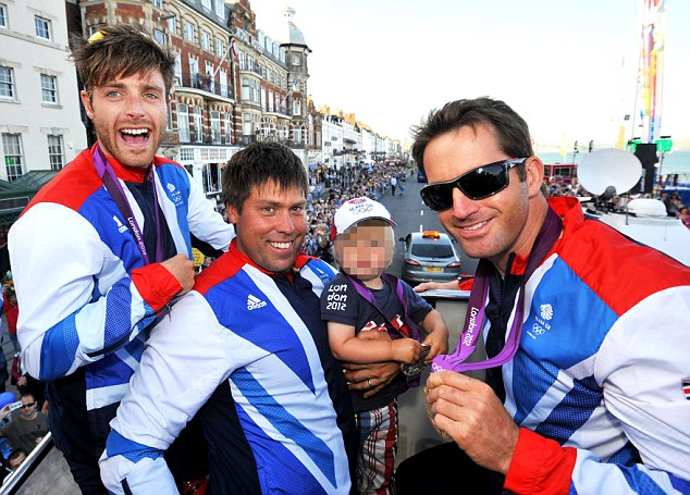 Fan fare: Luke Patience, Simpson with son Freddie and Ainslie on an open top bus tour of Weymouth and Portland