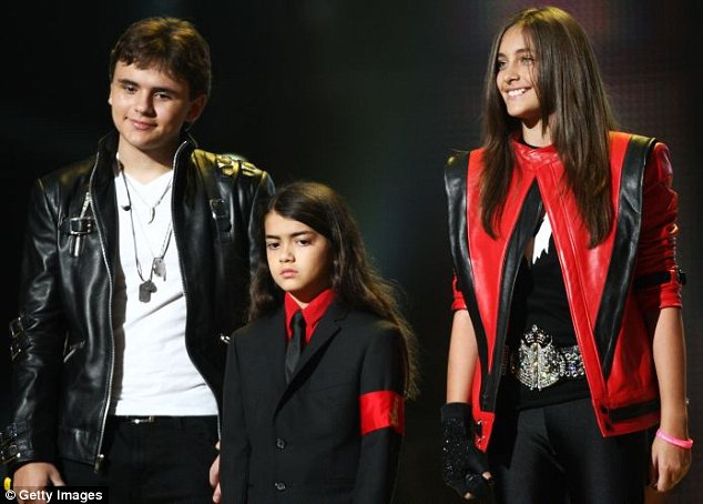Leading the way: It has been reported that Paris is trying to persuade brothers Prince Michael (L) and Blanket to follow her lead