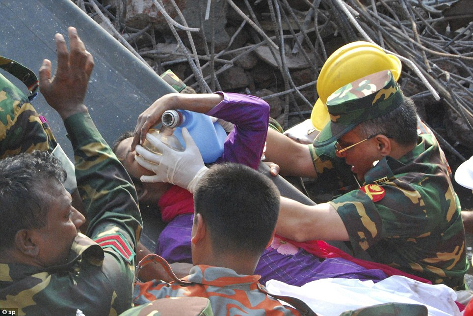 The woman, named Reshma and picture above, managed to alert rescuers by groaning and putting her hand out from beneath the rubble