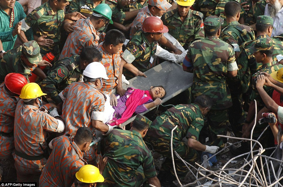 Jubilation: Hordes of rescue workers and army soldiers carry Reshma from the scene of the disaster