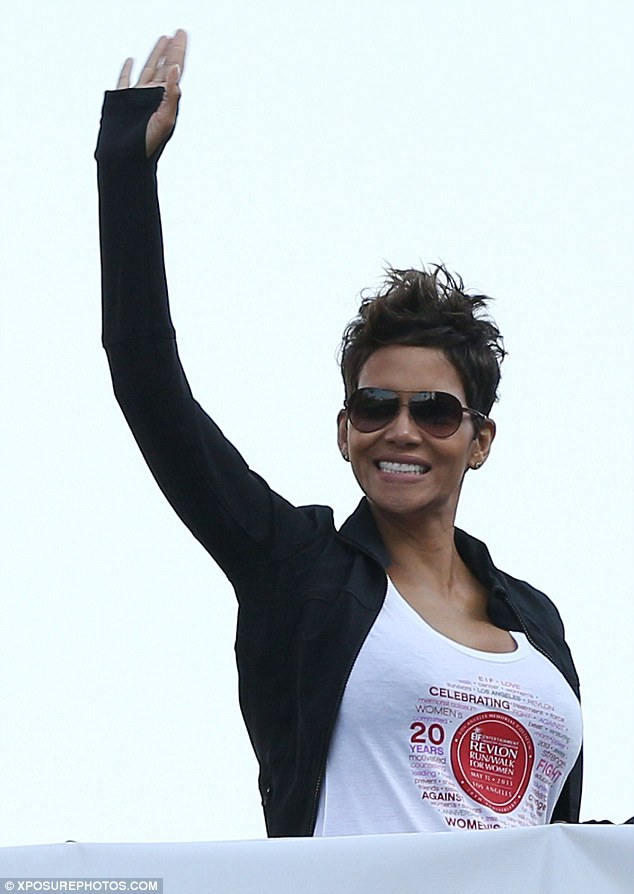 Jubilant: The actress flashed a huge grin for the crowd as she waved while leaving the stage