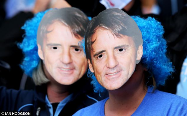 Masked maverick: Mancini is still loved by some quarters of Manchester City's support