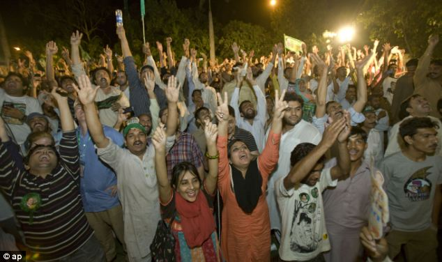 Supporters of Pakistan Muslim League-N party celebrate the primary unofficial results for the country's parliamentary elections
