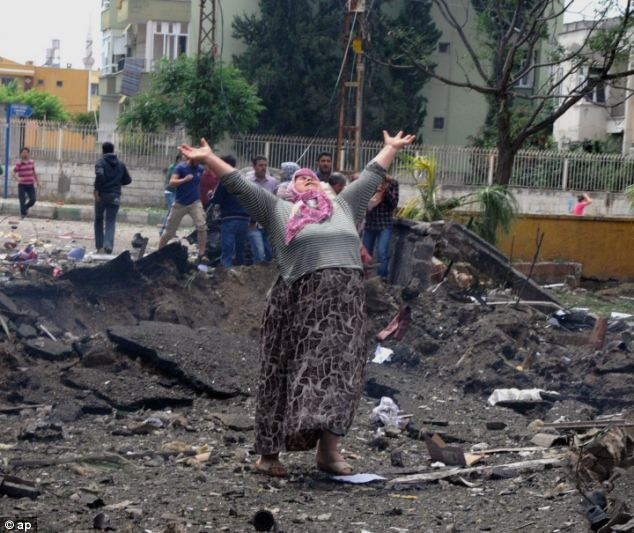 A woman cries at the scene of one of the explosion sites, after several explosions killed so many. The US has vowed to support Turkey in finding those responsible