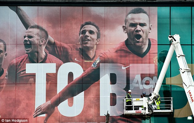 Poster boy: Rooney is the centre piece of a huge banner that will be unveiled at Old Trafford