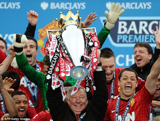 Fergie lifts the trophy