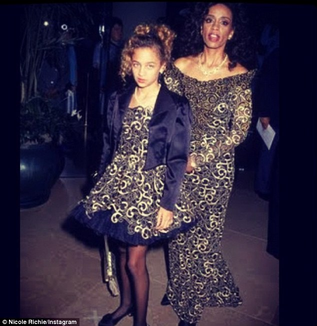 Jokester: Nicole Richie poked fun at her mother, writing of the pair's matching dresses, 'The one day I year I forgive her for this'