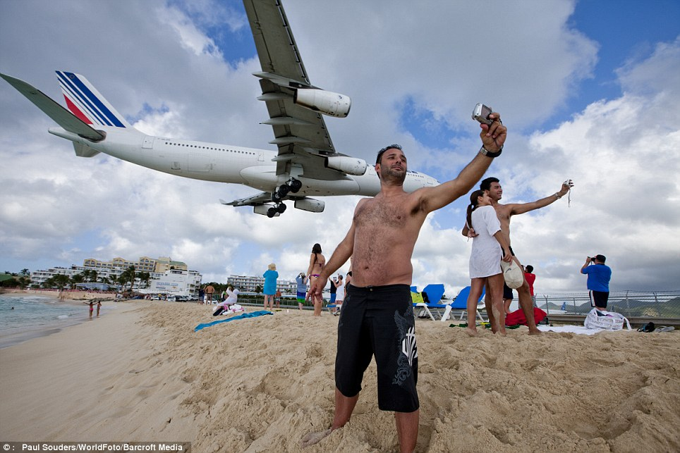 Something for everyone: The view of aeroplanes flying over the beach has become just as popular as sunbathing on it