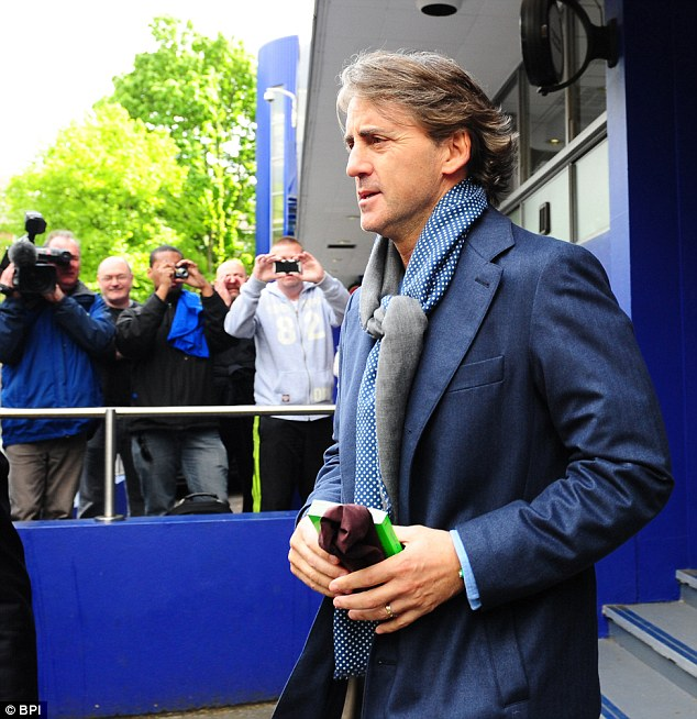 Lone Ranger: Manchester City manager Roberto Mancini leaves Loftus Road after a closed training session as speculation mounts over his future