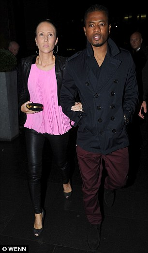 Winning mentality: Diminutive French star Patrice Evra and his wife Sandra