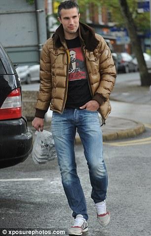 Star striker: Robin van Persie takes a stroll in Alderley Edge before the title parade