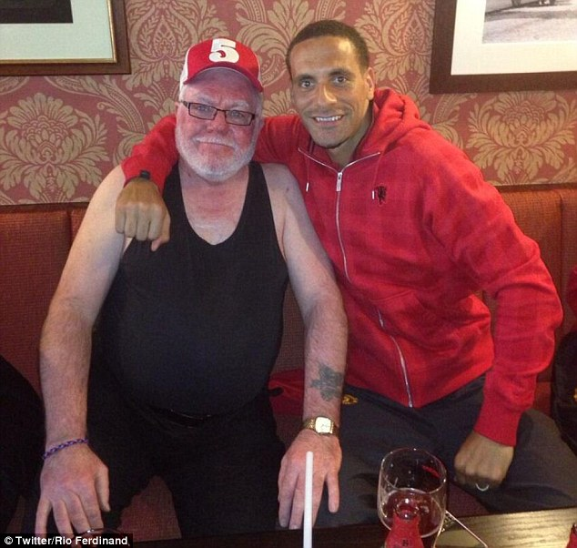 Company: Rio Ferdinand tweeted this picture of him and 'big dog' in a pub