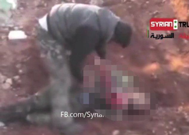Horrific: The amateur video posted on the Internet on Sunday shows Abu Sakkar, a founder of the rebel Farouq Brigade who is well known to journalists as an insurgent from Homs, cutting into the torso of a dead soldier