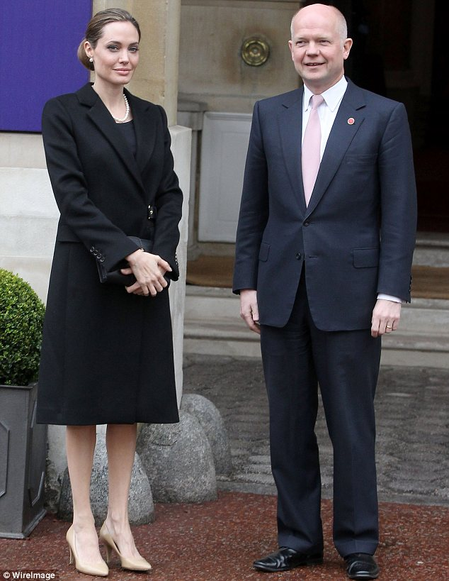 Still working hard: Angelina attended the G8 summit in London on April 11 with William Hague, after the initial operation but prior to the process being finished