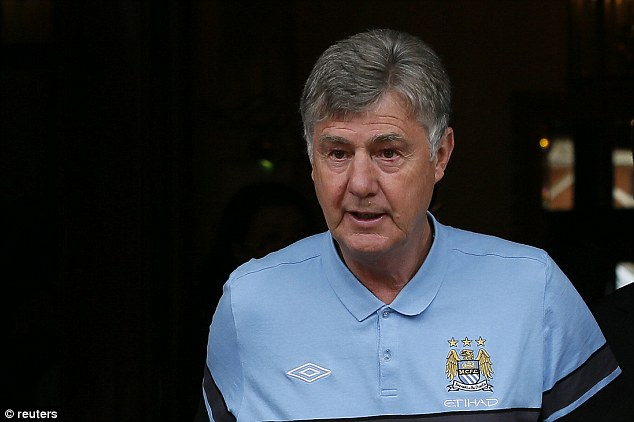 Stepping up: Brian Kidd, also seen today, takes over from Mancini for the last two matches of the season