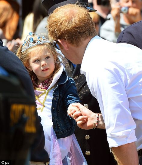Prince Harry is greeted by a young admirer at Mantoloking