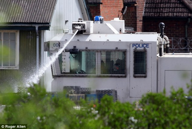 Duck and cover: Met police officers have been traveling to the training facility for the past two weeks to learn how to use the new water cannon