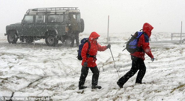 Making their way: Ramblers tried their best to battle through the snow in the Pennines in Cumbria