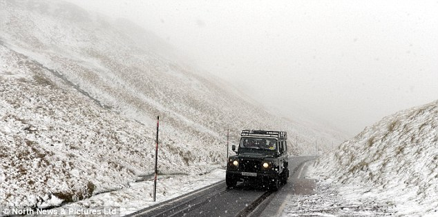 Difficult for drivers: Snow blizzards fall across the Pennines in Cumbria, covering vehicles and roads in snow