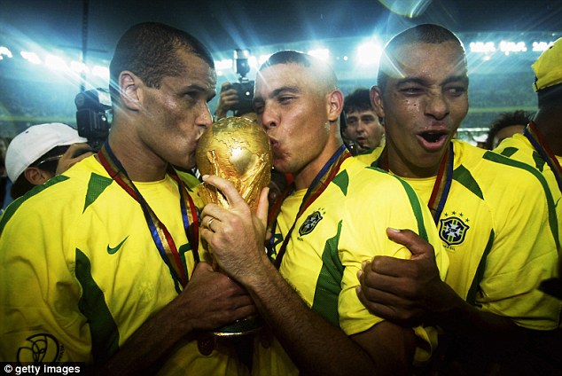 Another one: Rivaldo kisses the World Cup in 2002 after Brazil beat Germany 2-0 in the final