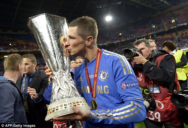 Silver touch: Fernando Torres poses with the Europa League in Amsterdam last night