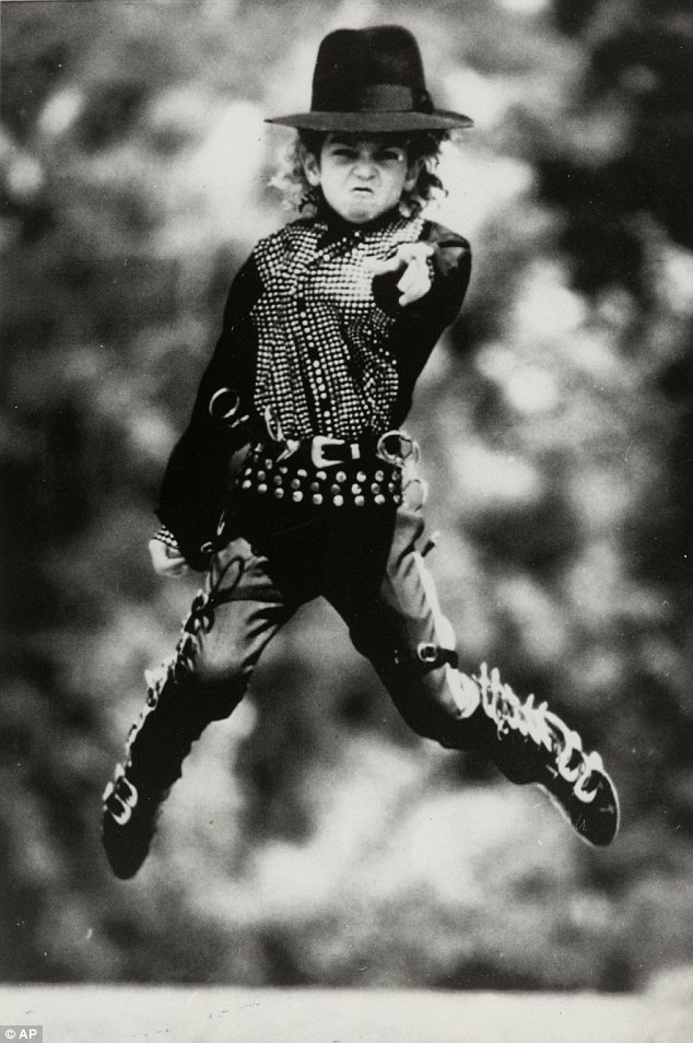 Idol: Robson, pictured as a young boy, first met Jackson when he won a local Michael Jackson competition in 1987