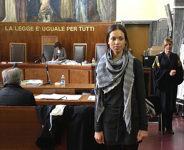 Questioned: Karima El Mahrough leaves the stand in the Milan courtroom