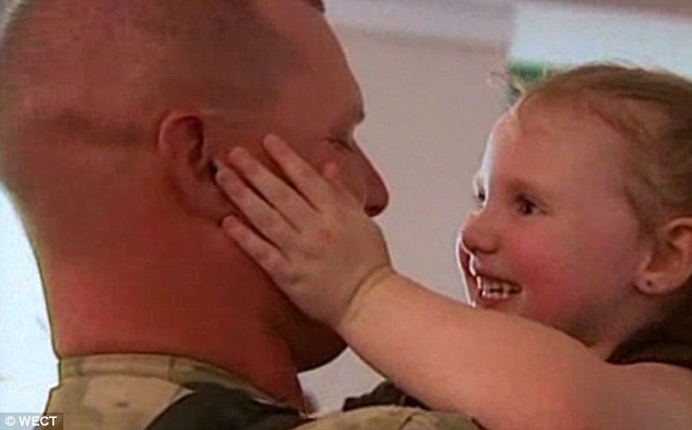 Overjoyed: Larry Shaffer's three-year-old daughter is overjoyed at her daddy's return