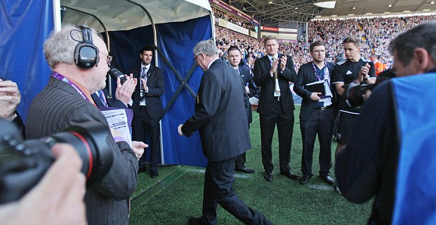 Tunnel vision: Manchester United manager Alex Ferguson walks down the tunnel for the last time