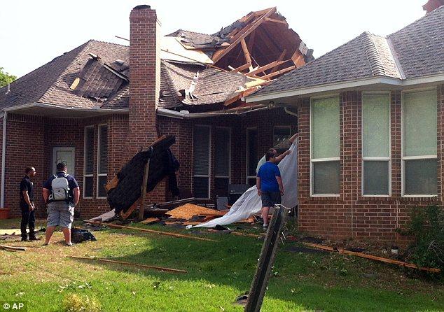 Damage: Residents of Edmond, Oklahoma survey storm damage from a tornado that hit their neighborhood