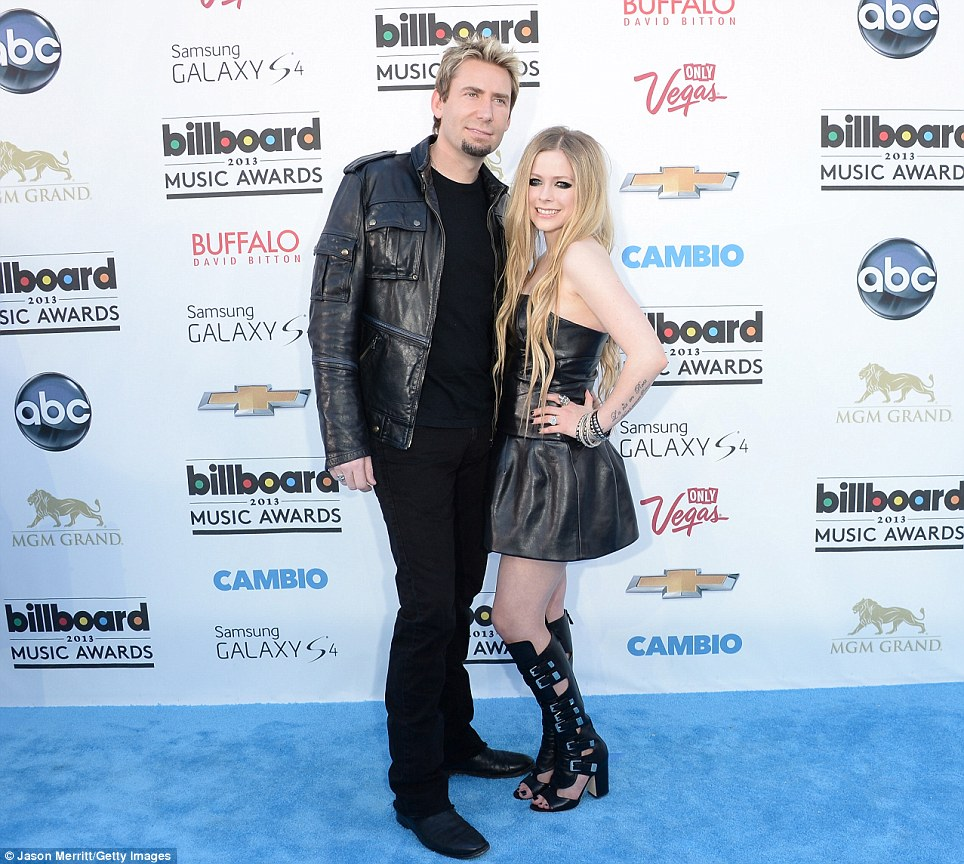Decade age difference: Canadian rock couple - Chad Kroeger and Avril Lavigne - coordinated with each other in black leather looks