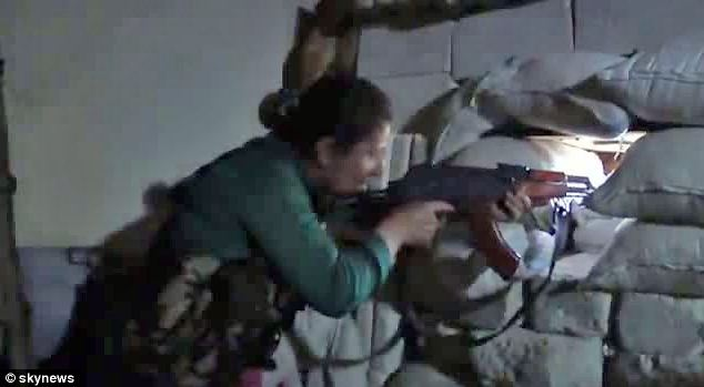 Battle: A Kurdish female fighter who is a sniper takes aim for her vantage point in Aleppo