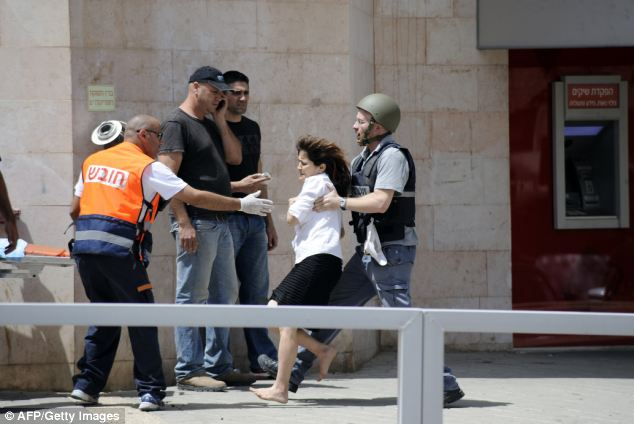 A woman hostage is evacuated by Israeli security forces following a bank robbery that escalated into a hostage situation in the Israeli city of Beersheva. Five people, including the gunman, were killed
