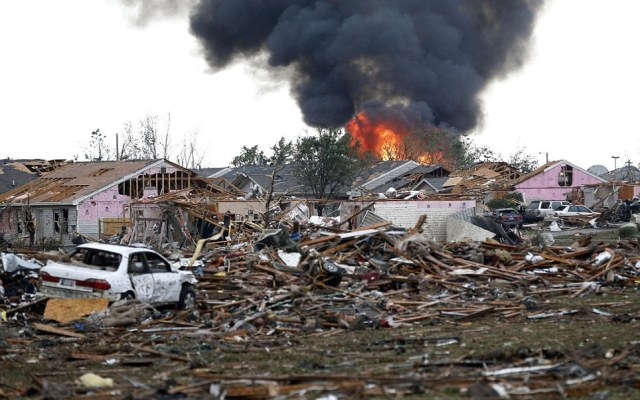 A fire burns in the Tower Plaza Addition in Moore, Oklahoma