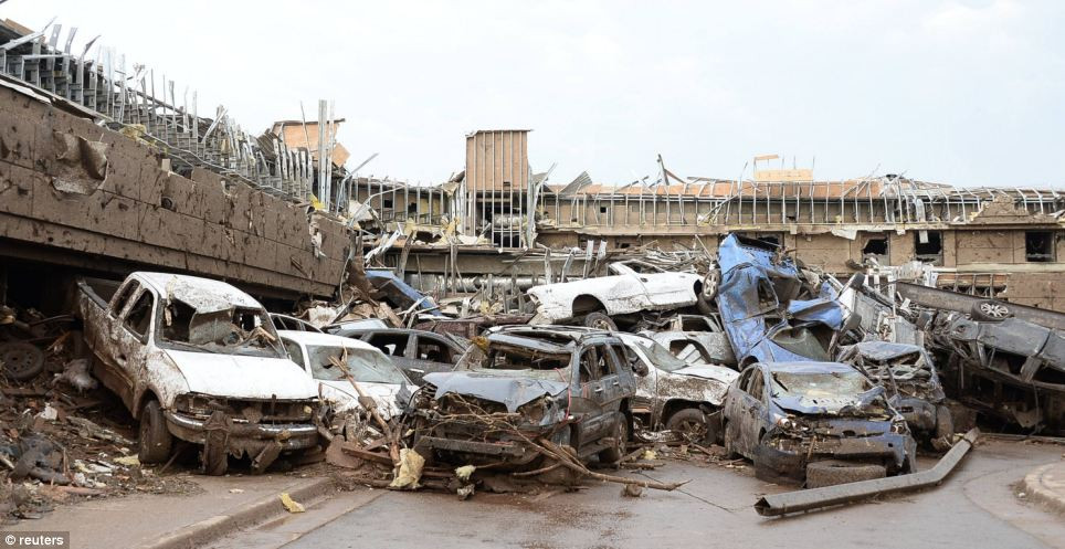 Dozen of cars piled up on top of each other in the parking lot of Moore Hospital