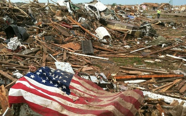 An American flag sits among devastation after the massive twister barreled through Moore, Oklahoma