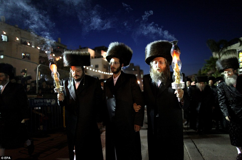 Future leader: The groom Shalom Rokeach, 18, pictured centre, is the grandson of the head of one of the largest Hasidic communities in Jerusalem, Belz Rebbe, and is expected to take his place as leader of the sect one day