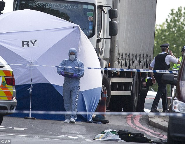 Investigations: A forensic tent is erected near the scene of the attack in Woolwich, south-east London