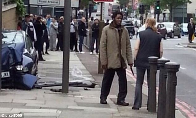 The woman appears to be remonstrating with a man who appears to be carrying a knife at the scene of the incident