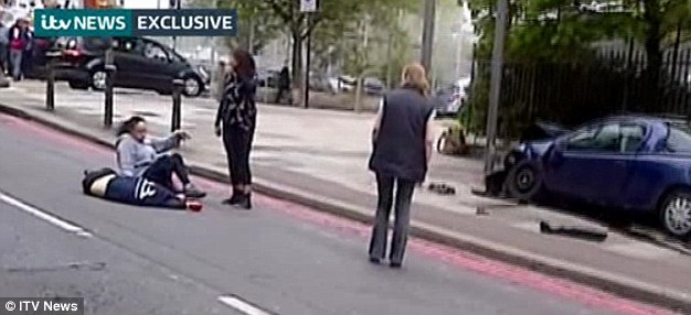 Murdered: The soldier (left) appears to be wearing a dark blue Help for Heroes hoodie or t-shirt