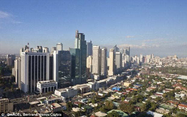 Defense: The chairman of metropolitan Manila, Francis Tolentino objected to the 'gates of hell' description, and to the city, pictured, being defined by what he calls terrible descriptions of poverty and pollution