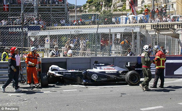 Collision: Pastor Maldonado was taken to a medical centre for checks after crashing his Williams