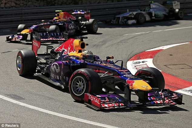 On the podium: Sebastian Vettel and Mark Webber came home second and third for Red Bull