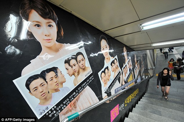 Pressure to be pretty: Cosmetic surgery is on the rise in South Korea and the beauty business is keen to capitalise on trends - with double-jaw surgery the latest must-have as another advert shows
