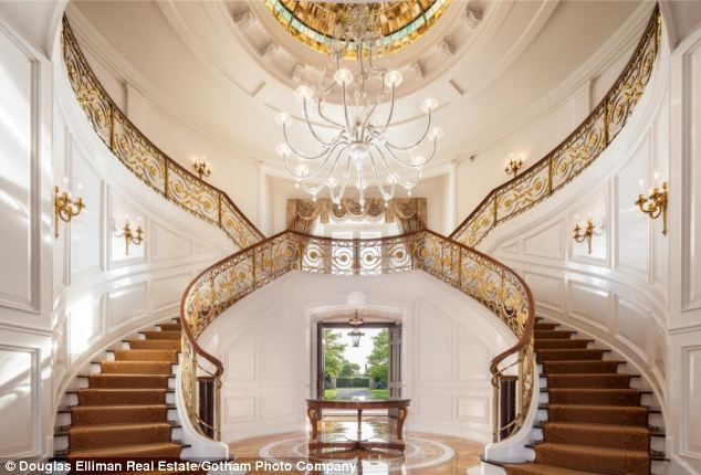 What a welcome: The grand entrance of the home, in Water Mill, New York, which was re-listed this week