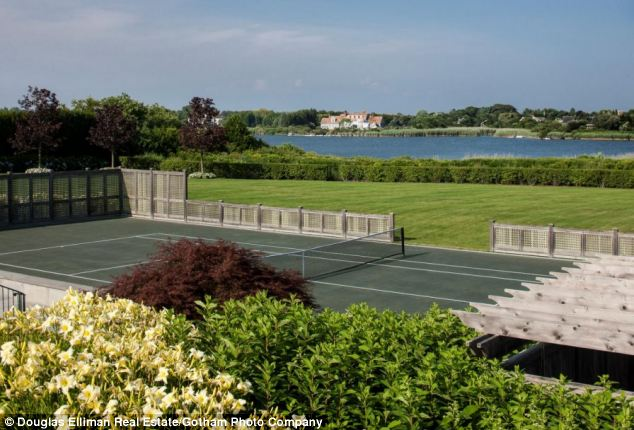 Everything you need: The tennis court at the home, which was re-listed by owner Andrew Borrock