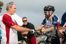 Outspoken: President George W Bush said during a three-day 100K bike ride he doesn't feel sorry for injured vets. Here, the former president stands with one of the riders, retired Staff Sargent Matt DeWitt, who lost his arms on duty in Iraq
