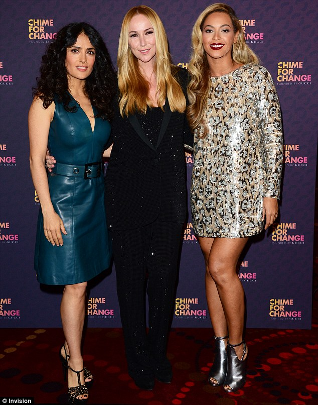 Lighting up the red carpet: Beyonce turned heads in a shimmering leopard print minidress as she posed alongside Salma Hayek and creative director of Gucci, Frida Giannnini, at the Sound Of Change concert on Saturday night