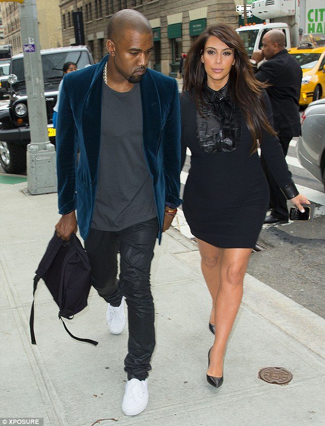 Rarely together: Kim Kardashian and her beau Kanye, pictured here in April, have both been jetting across the world, just rarely together