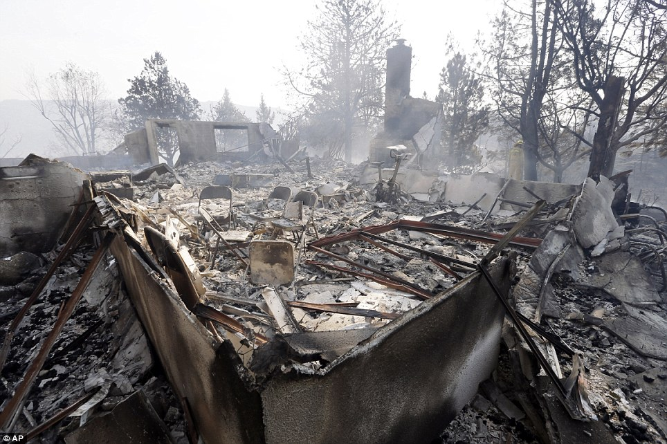 The house was burned down to its foundation, one of at least five victims of the wildfire